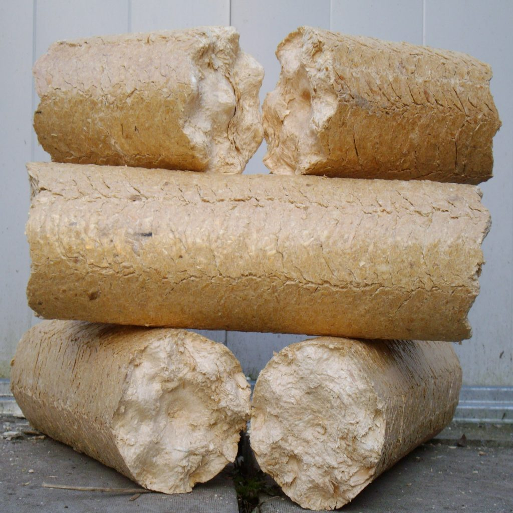 Bags of solid round heat logs made from pine and birch