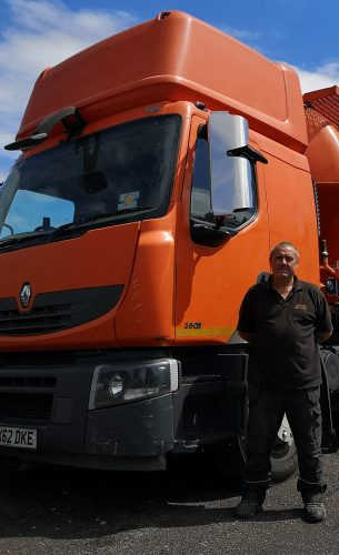 New driver mark stood next to new tanker truck.